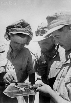 German Nazi propaganda photo depicts soldiers of the German Wehrmacht looking at a scorpion in Tunisia, published on 19 September 1941. Place unknown.