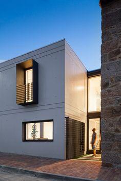 Filipe Pina + Maria Inês Costa add concrete extension to stone house
