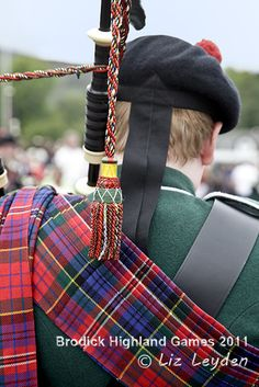 Young piper from Maybole Pipe Band playing at Brodick Highland Games, Isle of Arran. The tartan on his Piper's Plaid is Red MacPherson
