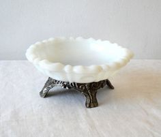 milk glass soap dish.... I'm pretty sure that is just an ash tray glued to a pedestal base - m