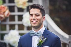 Love this navy blue groom's suit and gorgeous boutonniere!