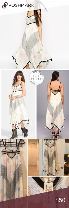 "Free People Crossing Paths Dress Colored Embroidery and stripes pattern a free-spirited dress detailed with a back cutout and tassels at the handkerchief hem. 43"" center front length, adjustable straps, lined. 100% cotton. Free People Dresses Midi"