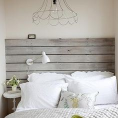 The Cross Decor & Design - bedrooms - reclaimed wood headboard, reclaimed wood slat headboard, reclaimed wooden slat headboard, mounted white desk lamp, adjustable white wall lamp, round white side table, round white accent table, white pillowcase, scalloped white pillowcase, yellow and white bee pillow, yellow and gray reversible quilt, yellow and gray quilt, vase of white flowers, industrial wire pendant, wire pendant, wire pendant lighting, plank headboard, two tone quilt,