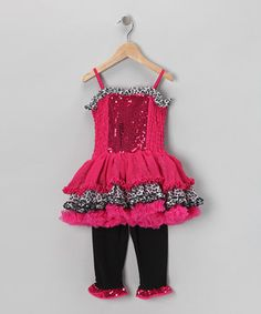 This bright burst of a dress boasts a sheer pink petal overlay and ruffles on the leggings' hemline. The smocked bodice features a corset-style back that laces up for hours of cozy and fancy fun.