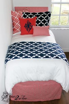 We adore this combination of navy quatrefoil with crazy coral prints. Coordinate with your roommate by each picking a different coral and navy bed in a bag set! Custom headboards, monogramming, and window panels complete the look.