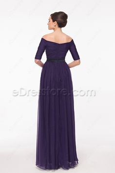 The dark purple mother of the bride dress features off the shoulder neckline, pleated bodice with black satin waistband, 1/2 sleeves, A line skirt finishes with floor length.