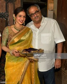 Sridevi and Boney Kapoor at Anil Kapoors Karwa Chauth party in Mumbai.this is the best pic of sreedevi . Beautiful colours with the right jewelry and make up. 10 out of 10 ,on a scale of Saree Blouse Patterns, Sari Blouse, Saree Dress, Saree Blouse Designs, Indian Attire, Indian Wear, Indian Outfits, Indian Clothes, Ethnic Fashion