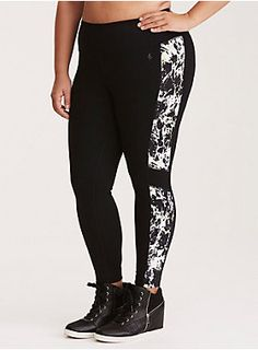 <div>Who says workout wear can't be killer fashion? We say look hot and move with comfort no matter what. Sexy. Edgy. Go for it. <b>Torrid Active - performance with attitude.</b></div><div><br></div><div>Just because you're working up a sweat, doesn't mean you can't be totally eye-catching. These black 4-way stretch leggings are paneled with a black, white and neon yellow abstract splatter print. Wicking technology keeps you cool and dry, while the mesh insets on the cropped legs catch...