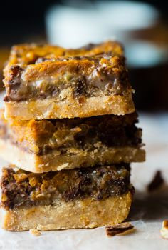 Vegan Pumpkin Spice Paleo Magic Cookie Bars - A healthier, dairy and gluten free version of the classic dessert that are packed with spicy-sweet fall flavors and are so easy to make!   Foodfaithfitness.com   @FoodFaithFit