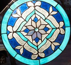 Stained Glass Window Panel 12''x12'' Round {9038-30} by PRECIOUS IMPORTS. $24.99. Each piece we offer is made from scratch and is 100% hand-cut and hand-crafted with the finest quality, Genuine Stained Glass. Tiffany-styled stained glass window panel is handmade and constructed of real glass.  Each piece we offer is made from scratch and is 100% hand-cut and hand-crafted with the finest quality, Genuine Stained Glass. From cutting the glass, to copper foiling the edges,...
