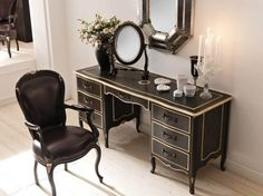 Black desk with gold edging. South Shore Decorating Blog: Black Lacquer: So Very Mary McDonald