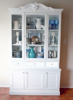 See how Remodelaholic took an ordinary old hutch and added new doors and base, to create a new white hutch with added drawers.