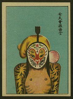 Des masques d'opéra chinois sur des cartes de cigarettes