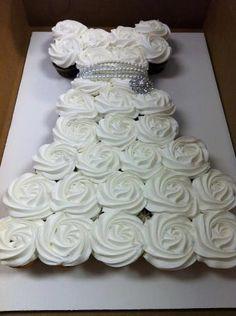 DIY Cupcake Wedding Dress Cake - Do-It-Yourself Fun Ideas Bridal shower idea – Dress shaped Cupcakes Wedding Dress Cupcakes, Bridal Shower Cupcakes, Cupcake Wedding, Diy Cupcake, Cupcake Display, Baptism Cupcakes, Cupcake Dress Cake, Rose Cupcake, Baptism Party