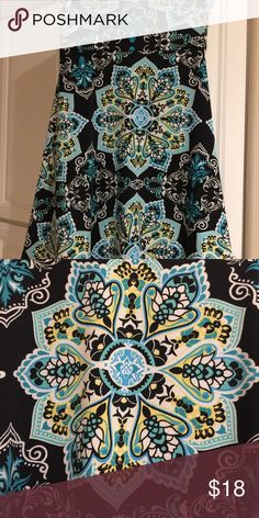 LuLaRoe sm Azure Skirt LuLaRoe Sm Azure skirt wore twice. Slinky material black, white, yellow and turquoise. LuLaRoe Skirts A-Line or Full
