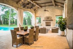 Lovely Mediterranean patio with exposed beam ceiling and fireplace.  #patios #outdoorliving homechanneltv.com