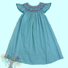 Rosalina angel wing sleeved Bishop Dress with red and white smocking on the neck line.  Visit www.hidenseekboutique.com to order