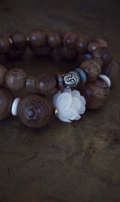 Men's mala bracelet with a carved white lotus and natural wood beads - great zen surfer style from The Pillow Book