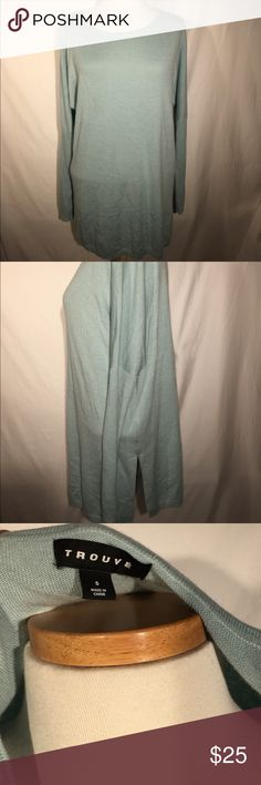 Trouve light blue long sleeve oversized sweater Trouve long sleeved sweater. Size Small, but fits for a long and oversized look. Slits on sides of sweater. Ribbed bottom half of sleeves. Small imperfection on front of sweater, a light stain that we have not tried to remove (see last picture). Not very noticeable. Shown in picture 4. Viscose/nylon/angora. Size small Trouve Sweaters Crew & Scoop Necks