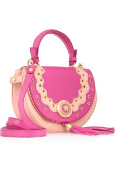 Versace 'two-tone eyelet-studded leather shoulder bag', for $1895.  In my dreams.  Adorable.