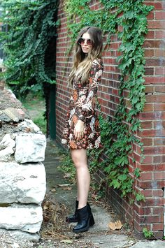 black booties w/ big heels modernize a crazy-printed 70s dress