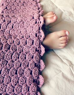 """This beautiful blanket uses a new crochet technique called """"rose petal crochet."""" It is an understated version of a crocodile stitch because it has a similar (though different) overall look and is worked in a much easier way."""