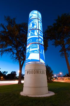 environmental totem put up in what seems like wood ward good color palette and nice design of a map on it