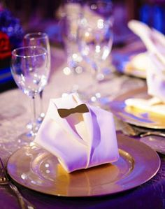 Cute napkin folding to look like a tuxedo! Little touches like this are adorable and creative too!