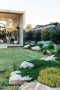 fig landscapes.com rocks and groundcovers small lawn walled, boxy veranda. breezeblocks
