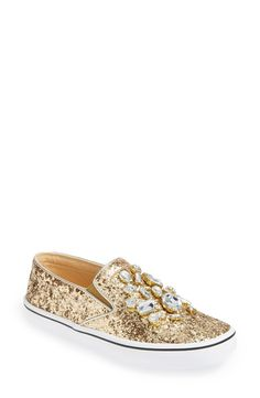 Head over heels for these gold crystal encrusted Kate Spade slip-on sneakers!