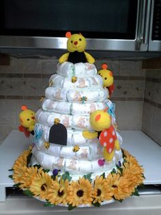 I made this Winnie-the-Pooh diaper cake beehive for my Niece Christina Terry's baby shower.
