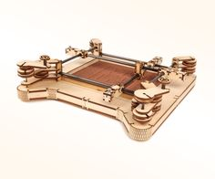 """With the XYZen Garden Kit, you can build your own mechanical zen garden with laser cut plywood parts, nuts and bolts, and some tubing. Enjoy a focused, meditative state as you turn the cranks to create your own designs in the sand.When I made the XYZen Garden earlier this year, it involved some fairly complex woodworking, so I decided to remake this project to be more accessible to more people. You can download the files in the """"Design"""" step, have them laser cut by Ponoko or another..."""
