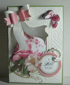 No instructions DIY: Cut out 2 butterflies, adhere and lift wings on top BF.  Use a wallie bow and sizzix flourishes...