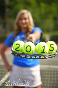 senior girl hold tennis racket with tennis balls on it with 2015 written on the…