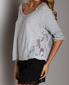 Sweatshirt with lace.  I have tons of sweatshirts that are short.   Cute look.
