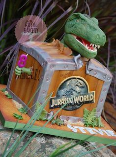 A Jurassic World cake for Stevie's birthday. The T-Rex head is carved styro coverd with fondant. T Rex Cake, Dino Cake, Dinosaur Cake, Birthday Party At Park, Dinosaur Birthday Party, Boy Birthday, Birthday Ideas, Jurassic World Cake, Festa Jurassic Park
