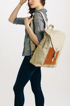 Chambray shirt and boxy taupe backpack I A well traveled woman