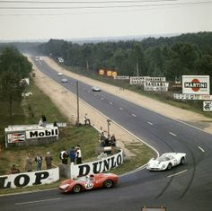 The Chris Amon/Nino Vaccarella Ferrari 330 Spyder leads the Pedro Rodriguez/Giancarlo Baghetti Ferrari 330 at the end of the Mulsane Straight, in the 1967 24 Hours of Le Mans. Sports Car Racing, Road Racing, Sport Cars, Auto Racing, Porsche, Martini, Le Mans France, Nascar, 24 Hours Le Mans