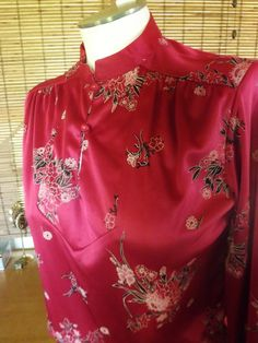 Vintage 60s Raspberry Asian style blouse By: Sears -Two frog style buttons at neckline -Mandarin collar -Gathered shoulder yokes -Floral print