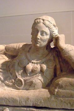 Detail of Etruscan terracotta sarcophagus lid of an elegant Etruscan lady C.300BCE