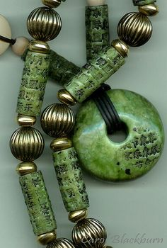 Faux Jade by Carol Blackburn. Love the dark green and slightly mottled appearance of the stone.