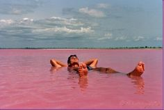 Situated north of the Cap Vert Peninsula in Senegal, northeast of Dakar, Lake Retba, or as the French refer to it Lac Rose, is pinker than any milkshake you've ever come face to straw with.  Experts say the lake gives off its pink hue due to cyanobacteria, a harmless halophilic bacteria found in the water.  Lake Retba has a high salt content, much like that of the Dead Sea, it has an almost one and a half times higher salt content than the Dead Sea.
