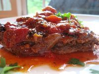 old fashioned swiss steak..one of my favorite comfort foods! I made this last nite for dinner and it was to die for! I also added celery to the sauce and carrots the last hour and sliced mushrooms the last 1/2 hour....served with mashed potatoes and homemade cornbread....it was to die for!