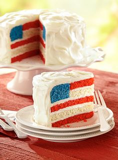 Flag Cake Layers and layers of buttery Red White and Blue cake form the perfect edible American flag.Layers and layers of buttery Red White and Blue cake form the perfect edible American flag.