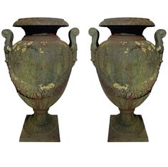1stdibs | A Pair Of 19th Century Green Painted and Weathered Cast Iron Garden Urns