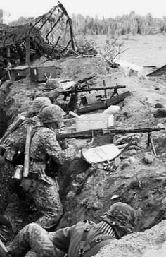 Machines gun position.  Note the spare barrel slung at the backs of the gunners.