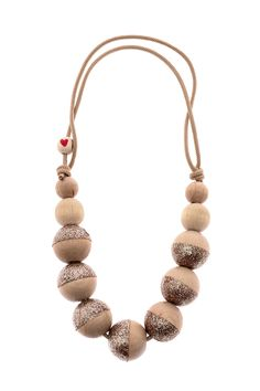 A simple wooden addition to any outfit. Wooden beads dip dyed in glitter.Layer with a couple or wear alone, either way it will complement your style.   Dip Dyed Glitter Necklace by The Bird's Word Boutique. Accessories - Jewelry - Necklaces Virginia