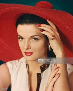 Jane Russell B.1921. In this Photo Ms Russell is left hand on forehead and right hand on left arm. Undated Portrait.