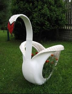 car tire swan :) Art at the playground. The kids could help paint it