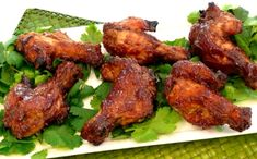 Ingredients           2 bottles of chili sauce   2 jars of grape jelly   1/2 cup honey   1 teaspoon fresh garlic   1 teaspoon cayenne pepper   1 teaspoon ground ginger   3 pounds chicken wings or chicken drumettes      Instructions       In a